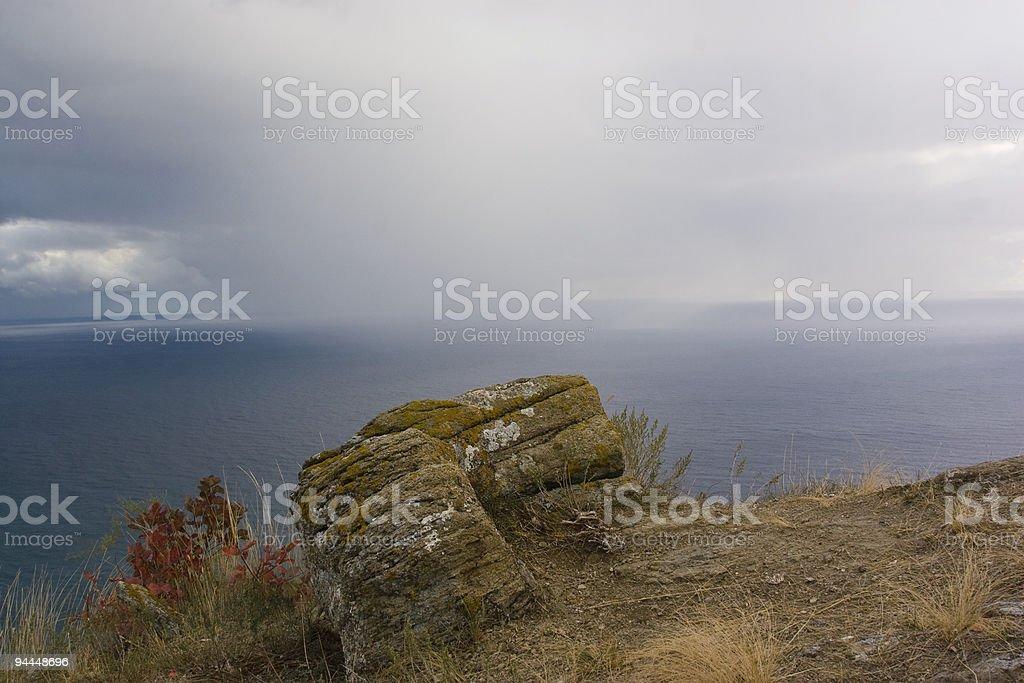 downpour over ocean stock photo