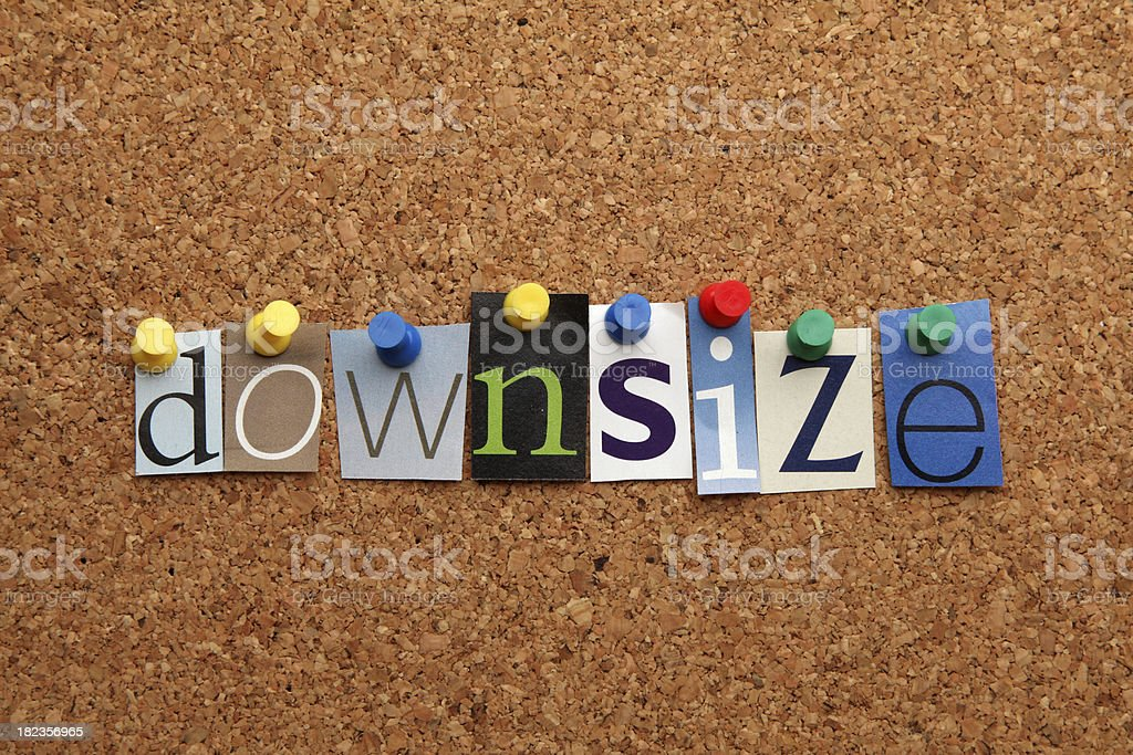 Downsize pinned on noticeboard royalty-free stock photo
