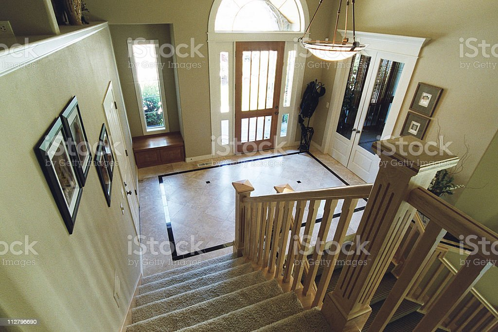 Downstairs view of entryway to a contemporary house. royalty-free stock photo