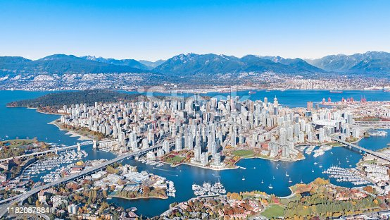 Aerial shot of Downtown Vancouver with Mountains, Skyscrapers, Bridges, burrard inlet in autumn