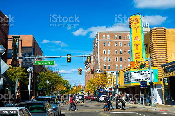 Downtown Ann Arbor With The State Theater And Pedestrians Stock Photo - Download Image Now