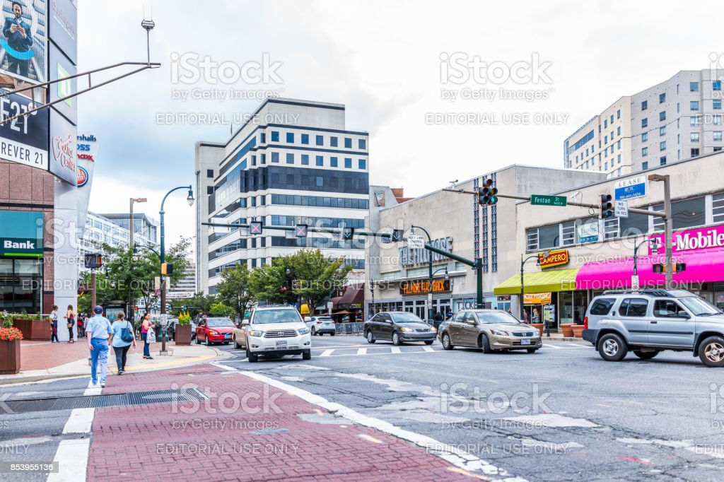 Downtown area of city in Maryland with cars on street, bus, and shopping mall stores, shops and people stock photo