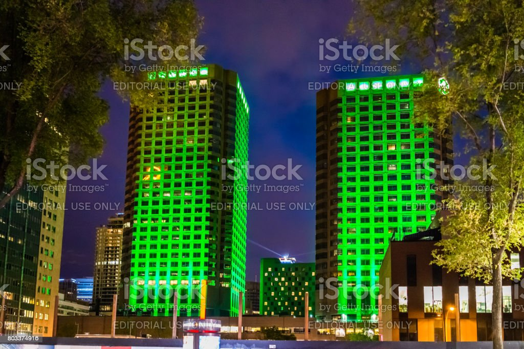 Downtown area with Complexe Desjardins green building at dark night evening outside in Quebec region city stock photo
