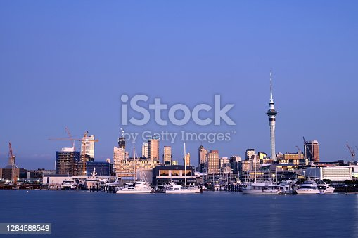 Downtown of the largest city in New Zealand under gorgeous, evening sky. The Sky Tower visible on the right is a telecommunications and observation landmark measuring 328 metres (1,076 ft) .