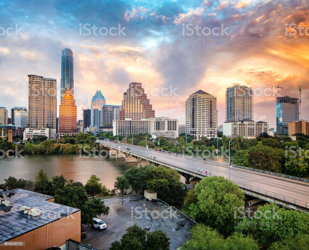 Downtown Austin skyline at sunset elevated view with Colorado river stock photo