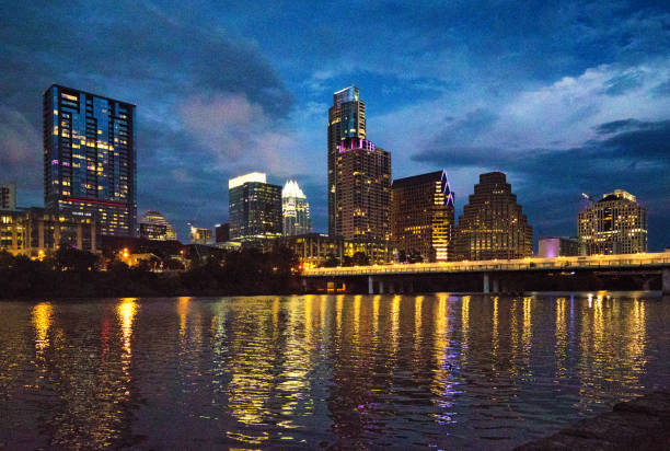 Downtown Austin skyline at twilight from Colorado River stock photo