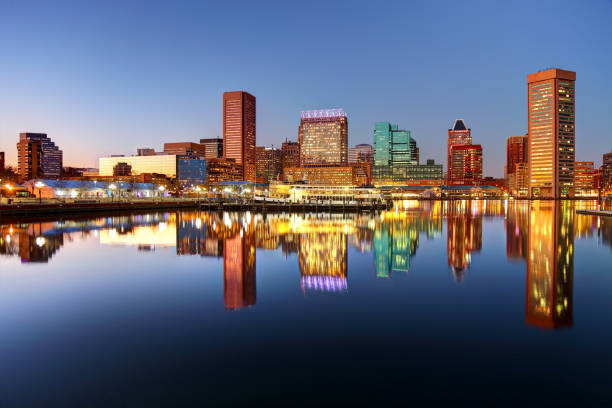 Downtown Baltimore Maryland Skyline The Inner Harbor is a historic seaport, tourist attraction, and landmark of the city of Baltimore, Maryland inner harbor baltimore stock pictures, royalty-free photos & images