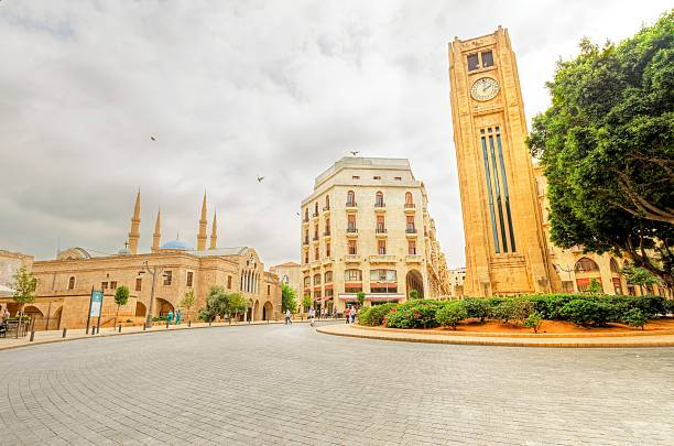 Downtown Beirut, Lebanon A view of the clock tower in Nejme Square in Beirut, Lebanon, some local architecture of downtown Beirut, the Mohammad Al-Amin mosque and Greek orthodox church of St George. beirut stock pictures, royalty-free photos & images