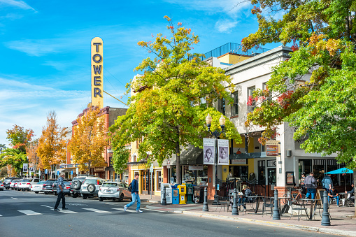 Pedestrians cross street in downtown Bend Oregon USA on a sunny day.