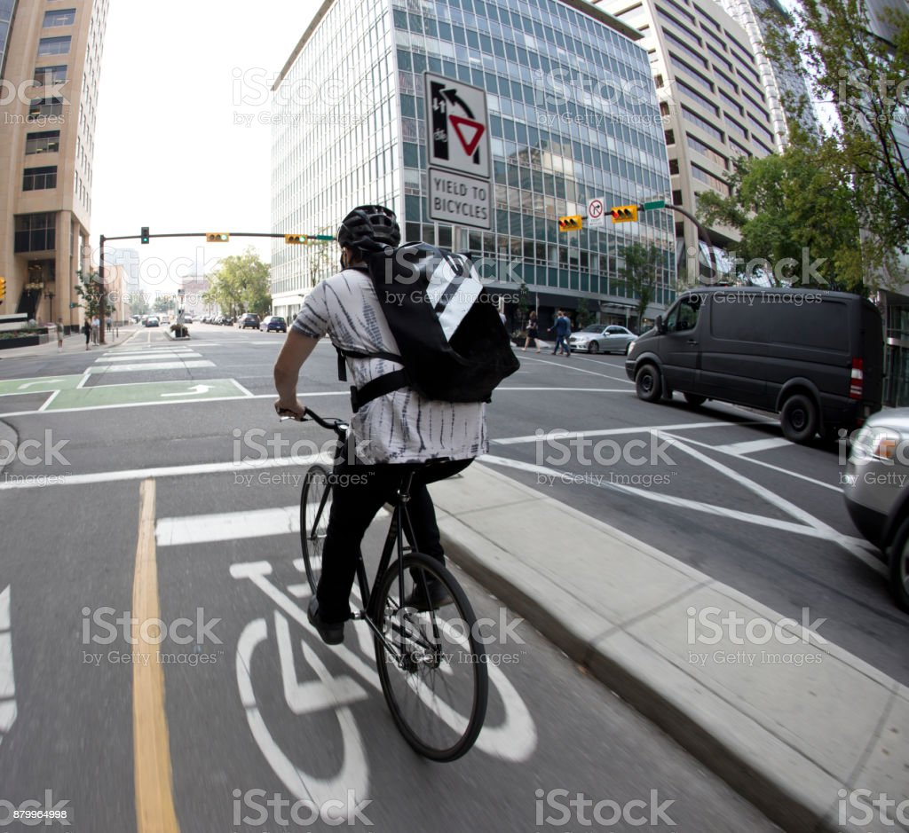 Downtown Bike Messenger stock photo