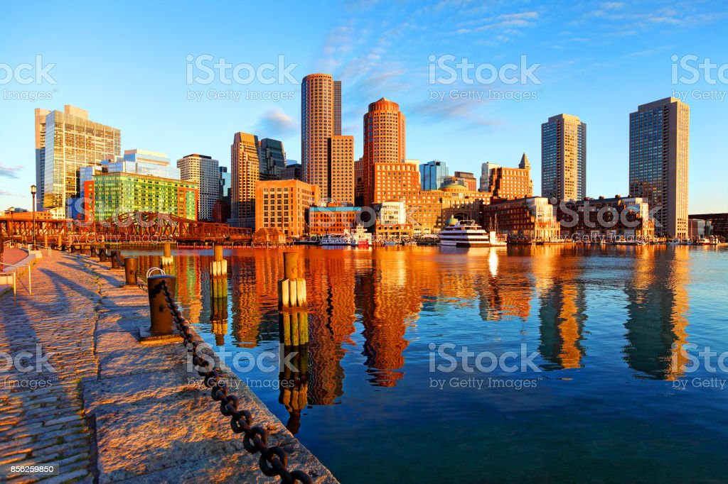 Downtown Boston skyline reflection on the harbor stock photo