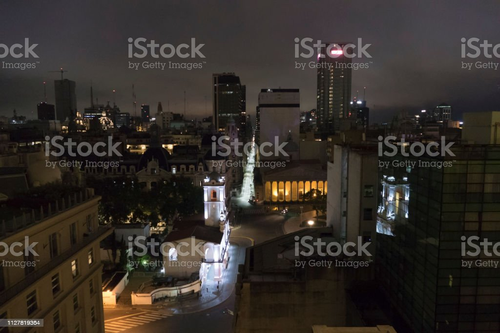 Downtown Buenos Aires nighttime streets skyscrapers Cabildo church Argentina stock photo