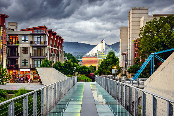 Downtown Chattanooga Chattanooga, Tennessee, USA downtown cityscape under a stormy sky. chattanooga stock pictures, royalty-free photos & images