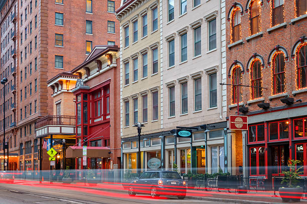 Downtown Cincinnati Ohio Colorful Pubs and Restaurants Photo of colorful pubs and restaurants and old historic facades on Walnut Street in downtown Cincinnati, Ohio, USA cincinnati stock pictures, royalty-free photos & images