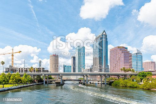 Tampa, USA - April 27, 2018: Downtown city in Florida with bridges skyscrapers office modern buildings and cityscape skyline construction crane panorama
