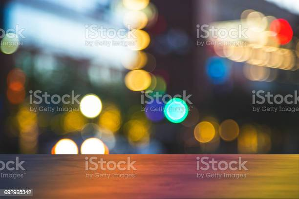 Downtown city night lights with blank bar counter table picture id692965342?b=1&k=6&m=692965342&s=612x612&h=lflwcghywxvlysmfhuxmzfwb2omaw dc bfzpiy b0g=