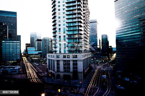Overhead look amongst the Denver Skyline with car light trails through the city streets.