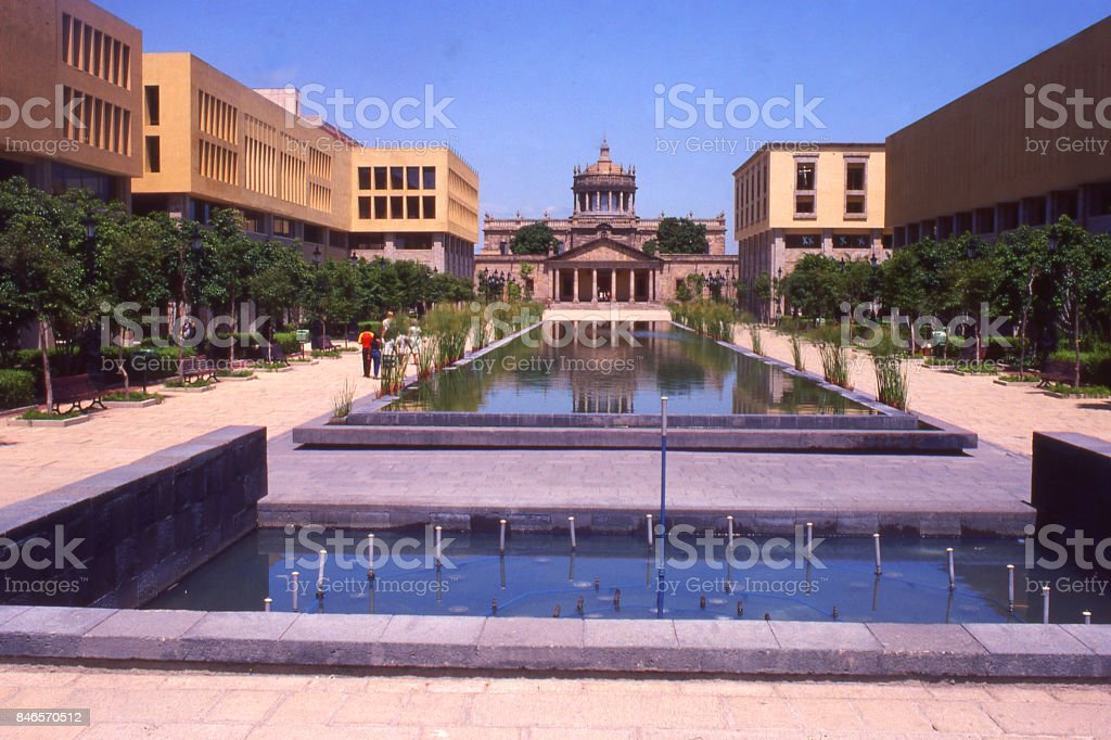 Downtown cityscape of Guadalajara and fountains and walkway to historic church Mexico stock photo