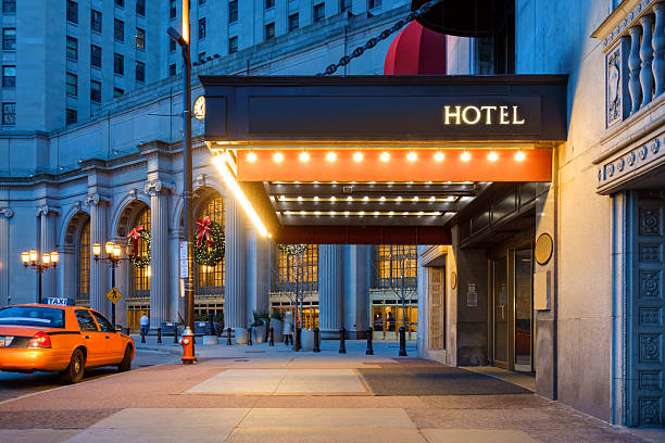 downtown cleveland hotel entrance and waiting taxi cab - entrance stock photos and pictures