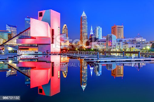 Cleveland, Ohio, USA - April 30, 2018: Evening view of the Rock and Roll Hall of Fame and Cleveland skyline reflecting on Lake Erie