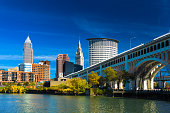 istock Downtown Cleveland with River, Bridge, Trees, and Deep Blue Sky 577622116