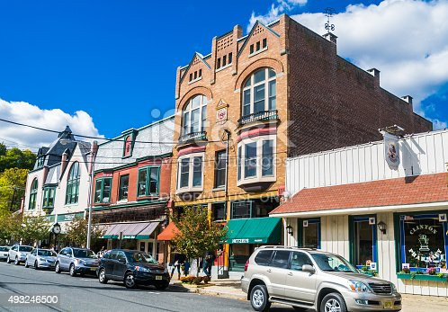 Clinton, New Jersey, USA - October 17, 2015: The Odd Fellows Building is flanked by the Clinton Pharmacy and an assortment other shops and restaurants, The many thriving small businesses in town make it a fun place to visit, dine and shop.