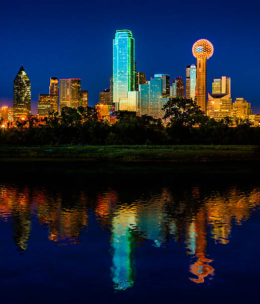 Downtown Dallas Cityscape Skyline Skyscrapers glowing at dusk / twilight stock photo