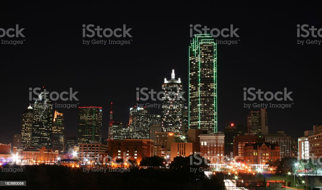 a photograph of downtown dallas from the top of a parking lot