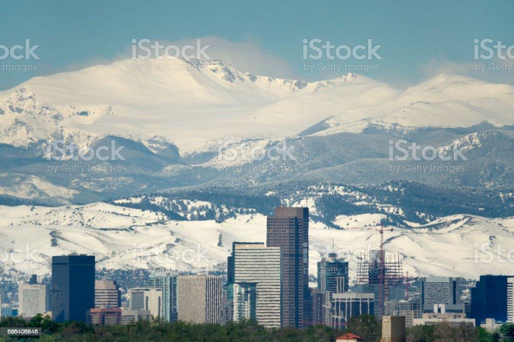 Downtown Denver snowy springtime Mount Evans Colorado Rocky Mountains stock photo