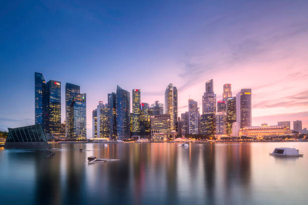downtown district and marina bay in singapore - singapore stock photos and pictures