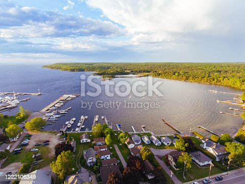 Aerial drone photography showing downtown Fish Creek and its marina, along with Peninsula State Park in Door County, Wisconsin