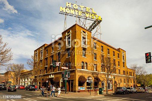 Flagstaff, Arizona USA - October 24, 2016: Cityscape view of the vintage red brick architecture of the historic Hotel Monte Vista in the downtown district on Aspen Avenue and San Francisco Street.