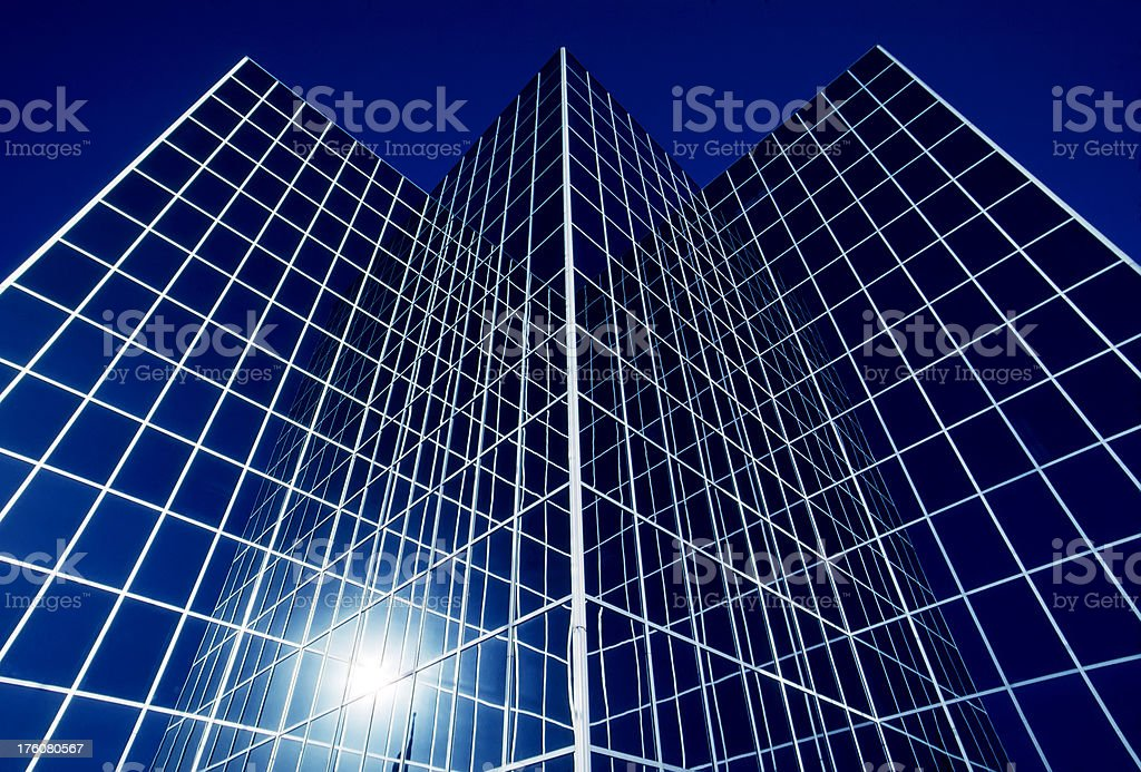 Downtown Glass Surface Modern Office Building Reflects Deep Blue Sky royalty-free stock photo