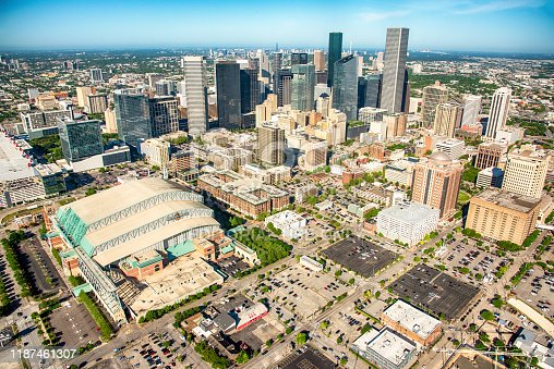 Houston, United States - April 10, 2019:  A wide angle view of the modern skyline of downtown Houston, Texas, America's fourth largest city, shot aerially from an altitude of about 1000 feet.