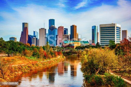 The skyline of downtown Houston, Texas shot from a bridge over the Buffalo Bayou within Eleanor Tinsley Park.