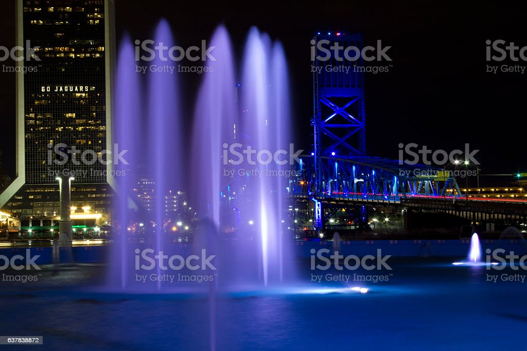 Downtown Jacksonville at Night with Bridge and Purple Fountain stock photo