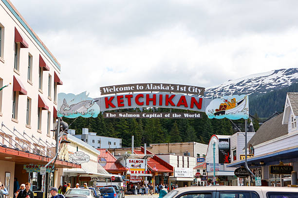 Downtown Ketchikan Alaska Ketchikan, Alaska, USA-July 5, 2013: Welcome sign  located in downtown Ketchikan's main street greets town visitors. Photograph was taken in the morning of July 5, 2013. The sign celebrates the fishing heritage of the town of Ketchikan. ketchikan stock pictures, royalty-free photos & images