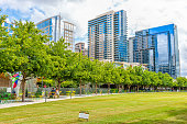 Dallas, USA - June 7, 2019: Downtown Klyde Warren green park in summer with lawn grass and cityscape skyline
