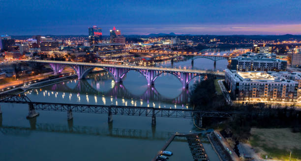 Downtown Knoxville Before Sunrise A pre-dawn shot of Downtown Knoxville over the Tennessee River. tennessee river stock pictures, royalty-free photos & images