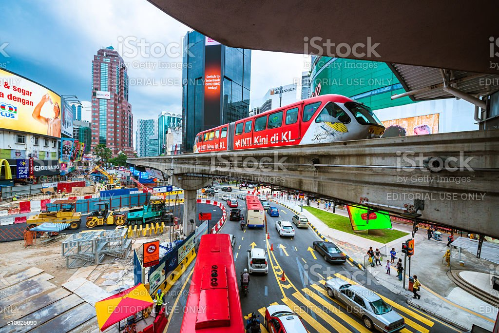 Downtown Kuala Lumpur with road, train, billboards and cars stock photo