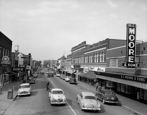 A view of downtown Lancaster, S.C. looking north on Main St. in November of 1953. The small mill town was home to Springs Cotton Mills for decades, which at one time boasted the world's largest cotton mill under one roof. (Photo by Lavoy Bauknight/Image on File with Travis Bell Photography)
