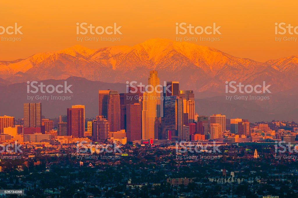 Downtown Los Angeles Aerial and Snow Capped Mountains at Sunset stock photo