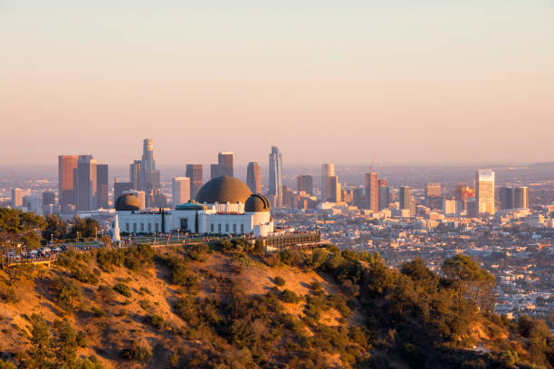 Downtown Los Angeles and Griffith Observatory at Sunset stock photo