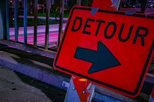 Downtown Los Angeles at Night Freeway Overpass Detour Sign Long Exposure stock photo