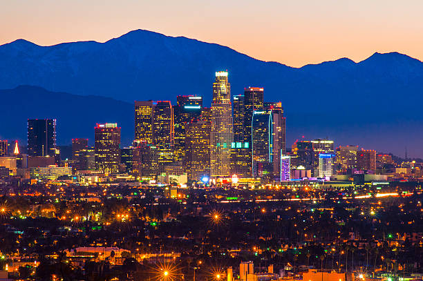 Downtown Los Angeles Skyline at Dawn with Mount Baldy Downtown Los Angeles skyline at dawn with Mount Baldy (a.k.a. Mount San Antonio) in the background. mount baldy stock pictures, royalty-free photos & images