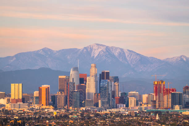 Downtown Los Angeles Skyline with Mountains Behind stock photo
