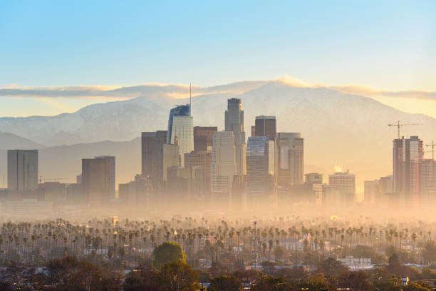 Downtown Los Angeles skyscrapers at smoggy sunrise stock photo