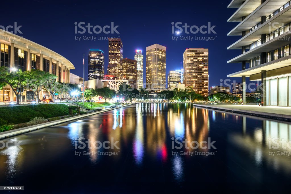 Downtown Los Angeles skyscrapers reflects in water at night stock photo