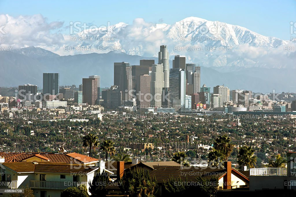 Downtown Los Angeles, Snow Covered San Gabriels stock photo