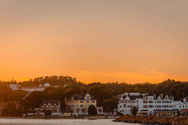 downtown mackinac island at sunset - mackinac island stock photos and pictures